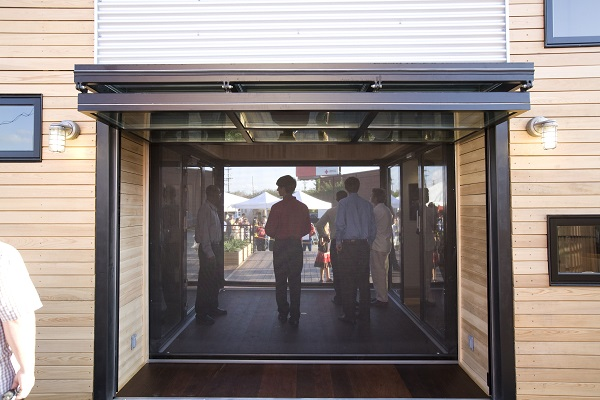 Folding Glass Garage Door For Restaurant Business by Action Door Cleveland Ohio