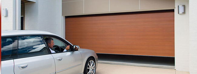 Wood Looking Residential Garage Door by Action Door